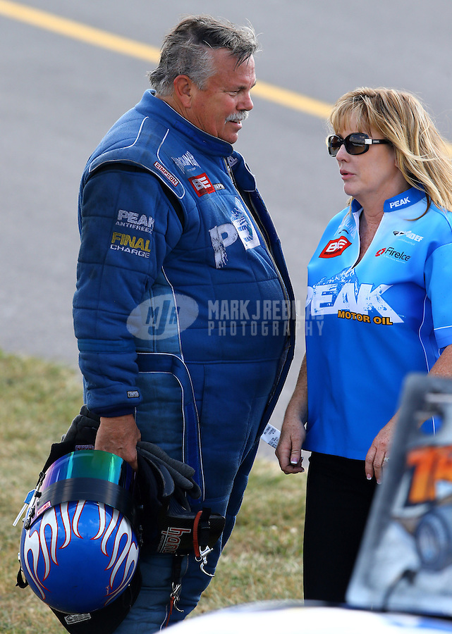 Aug. 30, 2013; Clermont, IN, USA: NHRA top alcohol funny car driver Jay Payne with wife Shelly Payne during qualifying for the US Nationals at Lucas Oil Raceway. Mandatory Credit: Mark J. Rebilas-