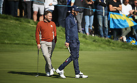 Dustin Johnson (Team USA) & Tyrrell Hatton (Team Europe) enjoying the craic on the 12th during Saturday's Fourballs, at the Ryder Cup, Le Golf National, Île-de-France, France. 29/09/2018.<br /> Picture David Lloyd / Golffile.ie<br /> <br /> All photo usage must carry mandatory copyright credit (© Golffile | David Lloyd)