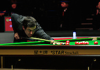 Ronnie O'Sullivan plays a shot on a red ball during the Dafabet Masters FINAL between Barry Hawkins and Ronnie O'Sullivan at Alexandra Palace, London, England on 17 January 2016. Photo by Liam Smith / PRiME Media Images