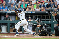 Michigan Wolverines second baseman Ako Thomas (4) follows through on his swing against the Vanderbilt Commodores during Game 2 of the NCAA College World Series Finals on June 25, 2019 at TD Ameritrade Park in Omaha, Nebraska. Vanderbilt defeated Michigan 4-1. (Andrew Woolley/Four Seam Images)