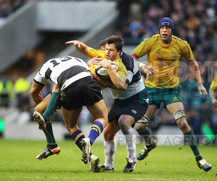 Robbie Fruen of the Barbarianstackles Adam Ashley Cooper of Australia during the Killik Cup