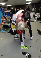 Pictured: Chico Flores of Swansea grabs and kisses kit lady Sue Eames in the dressing room after the game. Sunday 24 February 2013<br /> Re: Capital One Cup football final, Swansea v Bradford at the Wembley Stadium in London.