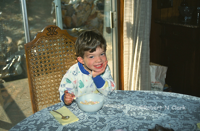 Boy with cereal bowl