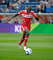 Chicago forward Dominic Oduro (8) drives toward the New England goal.  The Chicago Fire defeated the New England Revolution 3-2 at Toyota Park in Bridgeview, IL on Sept. 25, 2011.