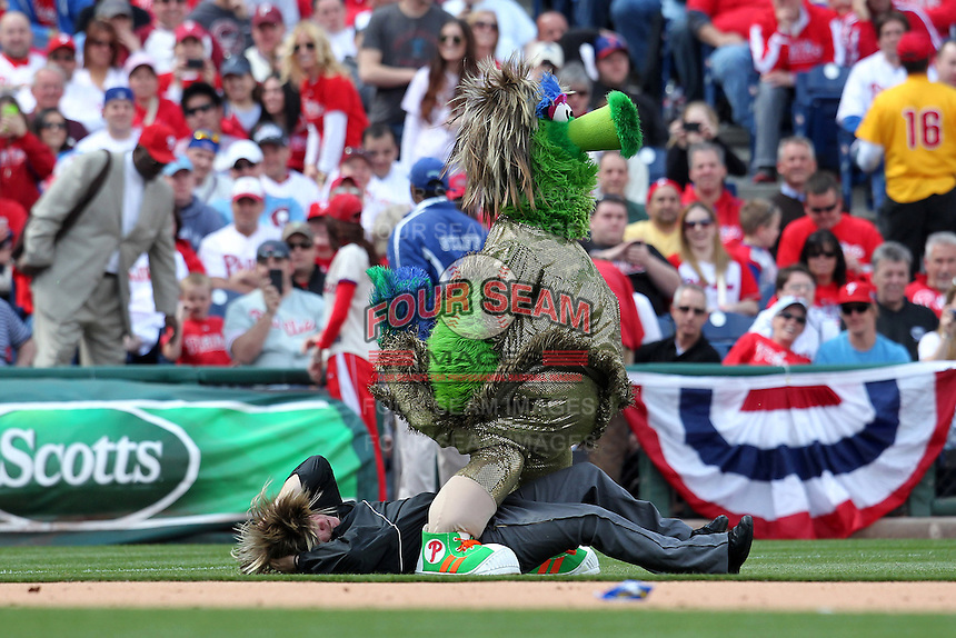 Philadelphia Phillies mascot the Phillie Phanatic does an on field bit with an assistant portraying an umpire during their home opener against the Miami Marlins at Citizens Bank Park on April 9, 2012 in Philadelphia, Pennsylvania.  Miami defeated Philadelphia 6-2.  (Mike Janes/Four Seam Images)