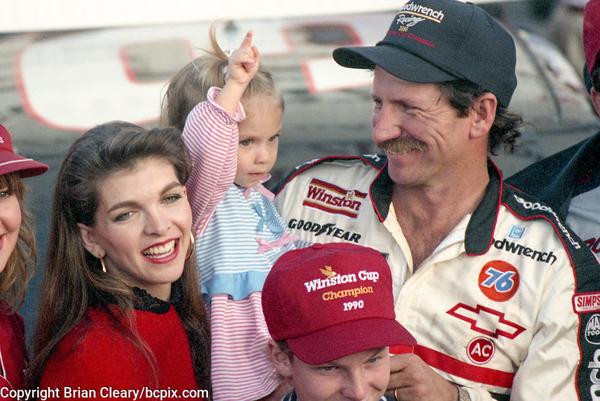 Dale Earnhardt celebrates his 4th Winston Cup championship with wife Teresa Earnhardt, daughter Taylor Earnhardt, and son Dale Earnhardt Jr., Atlanta Journal 500, Atlanta Motor Speedway, Hampton, GA, November 18, 1990. (Photo by Brian Cleary/bcpix.com)