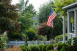 American Flag with Home in Rural America
