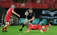 Ospreys' Olly Cracknell is tackled by Scarlets' Ken Owens<br /> <br /> Photographer Ashley Crowden/CameraSport<br /> <br /> Guinness Pro14 Round 6 - Ospreys v Scarlets - Saturday 7th October 2017 - Liberty Stadium - Swansea<br /> <br /> World Copyright &copy; 2017 CameraSport. All rights reserved. 43 Linden Ave. Countesthorpe. Leicester. England. LE8 5PG - Tel: +44 (0) 116 277 4147 - admin@camerasport.com - www.camerasport.com