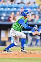 Lexington Legends left fielder Marten Gasparini (24) swings at a pitch during a game against the Asheville Tourists at McCormick Field on May 29, 2017 in Asheville, North Carolina. The Legends defeated the Tourists 5-2. (Tony Farlow/Four Seam Images)