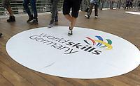 World Skills / WorldSkills 2013 in Leipzig - WM der Berufe - 2nd competition day - Besucher laufen über das Logo auf dem Boden in einer Röhre zur Glashalle. Foto: Norman Rembarz