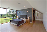 BNPS.co.uk (01202 558833)<br /> Pic: Jackson-Stops&amp;Staff/BNPS<br /> <br /> Stunning bedroom in the main house...<br /> <br /> For sale - Super home with its own leisure centre attached.<br /> <br /> The buyers of this stunning country property will never need to leave home again - with their own leisure complex at their fingertips.<br /> <br /> Birchwood House in Hoar Cross, Staffs, is a bespoke five-bedroom house that makes the most of the incredible countryside surrounding it with floor to ceiling windows in most rooms.<br /> <br /> But the really unusual selling feature is its unsurpassed leisure suite with a purpose-built gym, 15-metre swimming pool, sauna and steam room. <br /> <br /> It might save you a fortune in gym fees, but any wannabe owners will need &pound;2.75million to get their hands on this cutting edge, contemporary pad.<br /> <br /> The house also has a media room which currently has a pool table and a home cinema, meaning you really could settle in for the long haul.