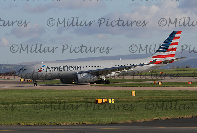 An American Airlines Airbus A330-243 Registration N283AY taxying at Manchester Airport on 14.2.16 bound for Philadelphia International Airport.