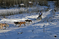 Saturday, February 24th, Knik, Alaska.  Jr. Iditarod musher MacKenzie Davis on the trail shortly after leaving the Knik start