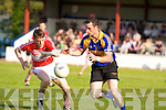 Kenmares Sean O'Leary races against Dingles Matthew Flaherty to gather possession during their county championship clash in Templenoe on Saturday.