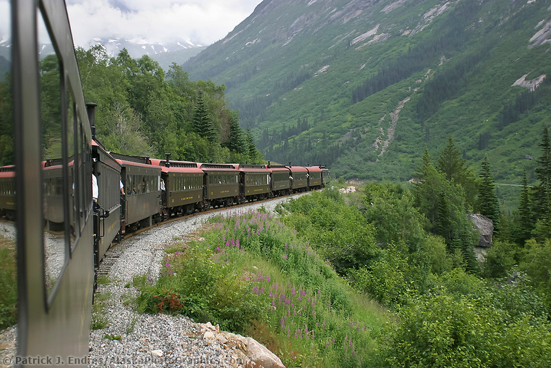 Historic White Pass and Yukon Route narrow gauge iron trail was born of the 1898 Klondike Gold Rush and built through some of the North's most ruggedly beautiful terrain. Refurbished train cars take passengers along the original route of the hopeful gold rush stampeders of 1898, Skagway, Alaska,