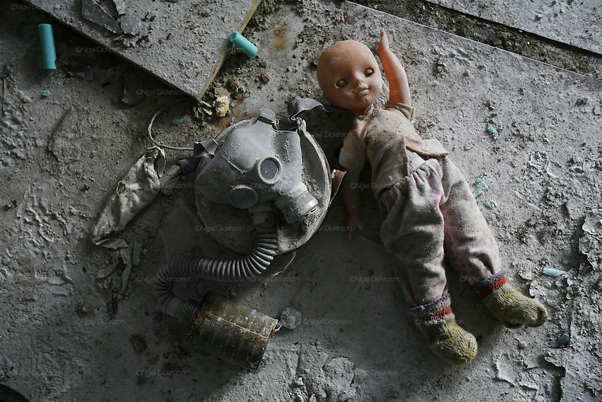 Chernobyl, Exclusion Zone, Ukraine. Dolls and gasmasks litter the  floor in  the Maternity Hospital. Pripyat Town built 15 years before the Chernobyl reactor fire. The whole town was evacuated shortly after. The  Chernobyl Reactor, towns, plant and environs just before the 20th anniversary of the nuclear disaster.