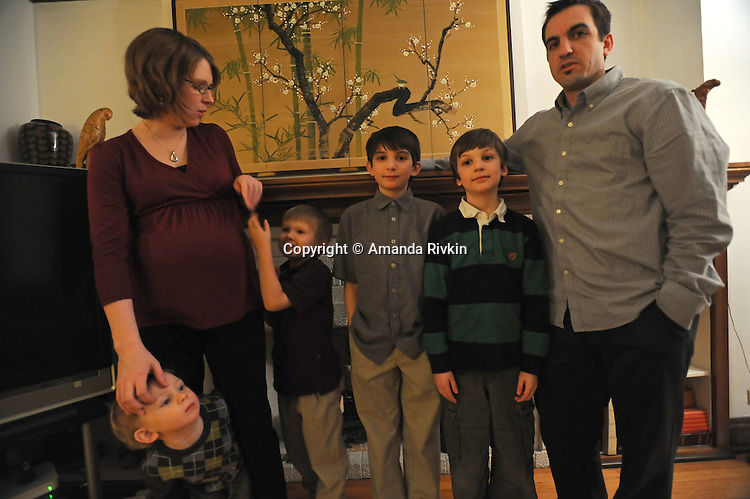 Meagan Francis, 31, and Jon Dodson, 32, with their four children (l-r) Owen Dodson, 3, William Dodson, 5, Jacob Dodson, 11, and Isaac Dodson, 9 at the home of Jon's colleague's in Evanston, Ill. on February 4, 2009.  Francis is pregnant with her fifth child.