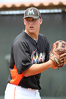 Miami Marlins pitcher Frank Reed #76 in the bullpen during an extended Spring Training game against the New York Mets at the Roger Deam Complex on May 1, 2012 in Jupiter, Florida.  (Mike Janes/Four Seam Images)