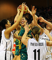 Ferns' Natasha Hall, Kate McMeeken-Ruscoe and Natalie Purcell try to get the ball off Hollie Grima during the International women's basketball match between NZ Tall Ferns and Australian Opals at Te Rauparaha Stadium, Porirua, Wellington, New Zealand on Monday 31 August 2009. Photo: Dave Lintott / lintottphoto.co.nz