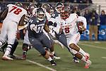 New Mexico quarterback Tevaka Tuioti (8) runs away from Nevada's Hausia Sekona (96) in the first half of an NCAA college football game in Reno, Nev., Saturday, Nov. 2, 2019. (AP Photo/Tom R. Smedes)