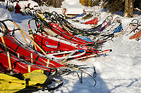 Line of replacement sleds awaiting mushers @ McGrath Chkpt 2006 Iditarod Interior Alaska Winter
