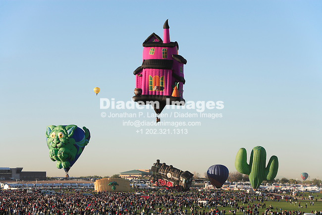 ALBUQUERQUE, NEW MEXICO - OCTOBER 10:  A number of unusually shaped hot air balloons during a mass ascension at the Albuquerque International Balloon Fiesta October 10, 2008 in Albuquerque, New Mexico. (Photograph by Jonathan P. Larsen)
