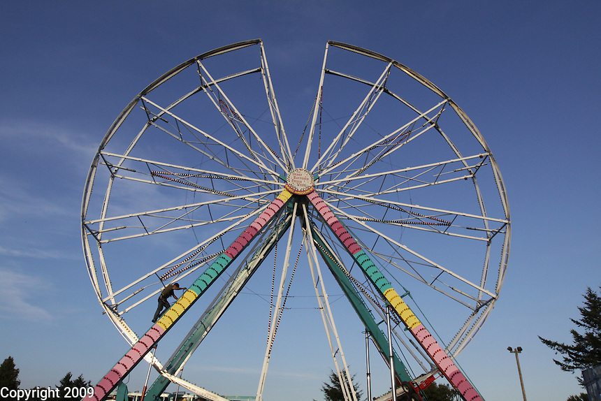 Carnival worker Ed Cagnina sets up the ferris wheel for the NW Washington Fair. August 16, 2009 PHOTOS BY MERYL SCHENKER            .schenker IMG_4345.JPG