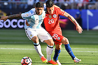 Argentina midfielder Evar Banega (19) and Chile midfielder Charles Aranguiz (20) battle for the ball during Copa America Centenario group D match, in Santa Clara, CA. Monday, Jun 06, 2016. Argentina won 2-1.(TFV Media via AP) *Mandatory Credit*
