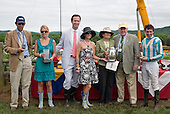 Anna Sloan (blue dress), a friend or one-time love interest of Prince William, heir to the English throne, helps present a trophy to Sonny and Ann Via (right), jockey Willy Dowling, and trainer Jack Fisher, far left, in the 2009 George andJohn Sloan Maiden Steeplechase at the Iroquois races in Nashville, TN.