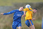 Paul Murphy of St Pats rises for an aerial ball with Colm O' Shea. Photograph by Declan Monaghan