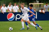 Nicholas Palodichuk (16) of the USA and A. J. Corrado (9) of the Academy select Team. The US U-17 Men's National Team defeated the Development Academy Select Team 5-3 during day two of the US Soccer Development Academy  Spring Showcase in Sarasota, FL, on May 23, 2009.
