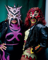 Amapola (left) & Diabolica pose for a photo before entering the ring in Ecatepec, Estado de Mexico. Mexico, June 2004