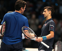 Novak Djokovic (SRB)(2) action against Milos Raonic (CAN)(4)  in their  Ivan Lendl Group  match during Day Three  of the Barclays ATP World Tour Finals 2015 played at The O2 Arena, London on November 15th  2016