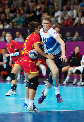 28 JUL 2012 - LONDON, GBR - Kathryn Fudge (GBR) of Great Britain (right) finds her path to goal blocked by Ana Djokic (MNE) of Montenegro (left, in red and gold) during the women's London 2012 Olympic Games Preliminary round handball match at The Copper Box in the Olympic Park, in Stratford, London, Great Britain .(PHOTO (C) 2012 NIGEL FARROW)