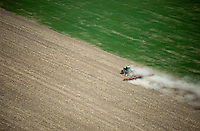Colorado farmer plowing with tractor, eastern Colorado plains. May 2014. 83923