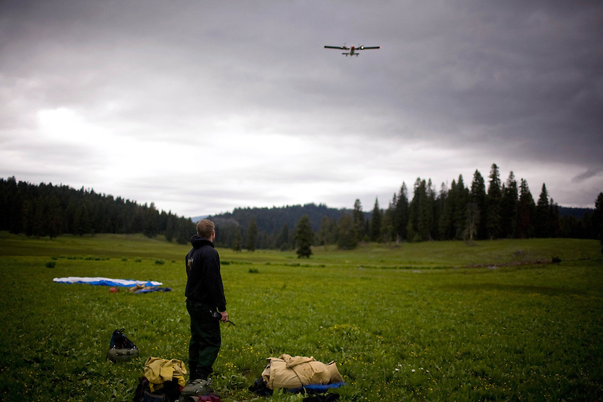 A twin-otter airplane passes overhead during a training exercise for the smokejumpers at the base in McCall, ID.