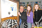 Artist Eduard Schmidt-Zorner (Dromin West, Milltown) shows Emma and Julia O'Neill Killorglin on of his paintings during his Symbolic Art exhibition in Killorglin library on Saturday    Copyright Kerry's Eye 2008