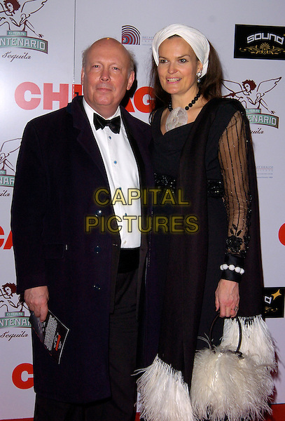 "SIR JULIAN FELLOWES & EMMA KITCHENER-FELLOWES.The ""Chicago"" 10th anniversary afterparty, Sound bar & nightclub, London, England..December 5th, 2007.half length black coat blue headscarf white feathers white scarf sheer married husband wife.CAP/CAN.©Can Nguyen/Capital Pictures"