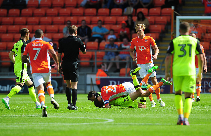 Exeter City's Craig Woodman is fouled by Blackpool's Danny Pugh<br /> <br /> Photographer Kevin Barnes/CameraSport<br /> <br /> Football - The EFL Sky Bet League Two - Blackpool v Exeter City - Saturday 6th August 2016 - Bloomfield Road - Blackpool<br /> <br /> World Copyright © 2016 CameraSport. All rights reserved. 43 Linden Ave. Countesthorpe. Leicester. England. LE8 5PG - Tel: +44 (0) 116 277 4147 - admin@camerasport.com - www.camerasport.com