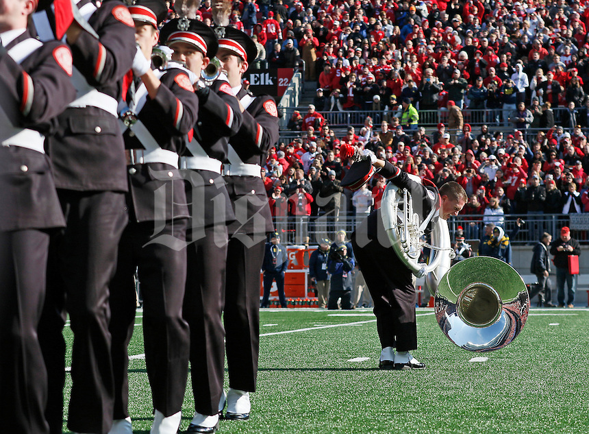 Seth Justice of Waverly, Ohio dots the i as the Ohio State Marching Band does Script Ohio prior to the NCAA football game against the Michigan Wolverines at Ohio Stadium on Nov. 29, 2014. The Buckeyes won 42-28. (Adam Cairns / The Columbus Dispatch)