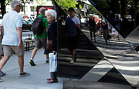 01 JUL 2014 - CHICAGO, USA - People walk along North Michigan Avenue in Chicago in the USA (PHOTO COPYRIGHT © 2014 NIGEL FARROW, ALL RIGHTS RESERVED)