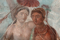 Fresco of Mars and Venus, 1st century AD, on the West wall of the North portico, painted on a water filter tank servicing the fountains, in the Casa dell Efebo, or House of the Ephebus, Pompeii, Italy. This is a large, sumptuously decorated house probably owned by a rich family, and named after the statue of the Ephebus found here. The fresco depicts Venus and Mars with Cupid holding a canopy over them, in a mountainous setting. It is painted in the Fourth Style of Roman wall painting, c. 60–79 AD, a complex and Baroque style. Pompeii is a Roman town which was destroyed and buried under 4-6 m of volcanic ash in the eruption of Mount Vesuvius in 79 AD. Buildings and artefacts were preserved in the ash and have been excavated and restored. Pompeii is listed as a UNESCO World Heritage Site. Picture by Manuel Cohen