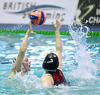 PICTURE BY CHRIS MANGNALL/SWPIX.COM - Water Polo - British Water Polo Championships 2012 - Women's Final, Manchester v London Otters - Manchester Aquatics Centre, Manchester, England - 19/02/12 - Manchester's Sarah Pimblett (w) v London Otters Michaele Krejci.