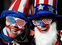 Two USA football fans smile for cameras. USA vs Slovenia in the 2010 FIFA World Cup at Ellis Park in Johannesburg, South Africa on June 18th, 2010.