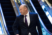 Trump advisor Gary Cohn is seen dismounting from an escalator in the lobby of Trump Tower in New York, NY, USA on December 14, 2016. Credit: Albin Lohr-Jones / Pool via CNP