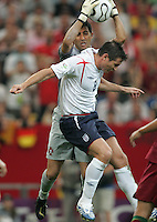 Portuguese goalkeeper (1) Ricardo pulls the ball away from the head of English midfielder (8) Frank Lampard.  Portugal defeated England on penalty kicks after playing to a 0-0 tie in regulation in their FIFA World Cup quarterfinal match at FIFA World Cup Stadium in Gelsenkirchen, Germany, July 1, 2006.