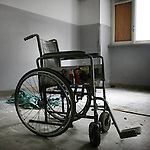 An abandoned wheelchair in Assam's room