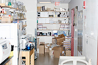 Equipment stands on shelves and counters in George Church's Lab in the New Research Building at Harvard Medical School's Department of Genetics in Boston, Massachusetts, USA, on Tues., Sept. 5, 2017.