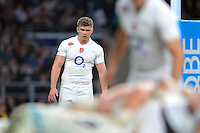 Owen Farrell of England watches a scrum. QBE International match between England and Australia on November 29, 2014 at Twickenham Stadium in London, England. Photo by: Patrick Khachfe / Onside Images