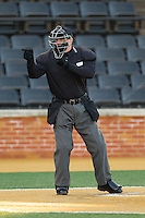 Home plate umpire David Pritchett makes a strike call during the NCAA baseball game between the Georgetown Hoyas and the Wake Forest Demon Deacons at Wake Forest Baseball Park on February 16, 2014 in Winston-Salem, North Carolina.  The Demon Deacons defeated the Hoyas 3-2.  (Brian Westerholt/Four Seam Images)